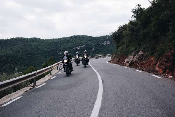 Group of motorcycle riders on mountain road