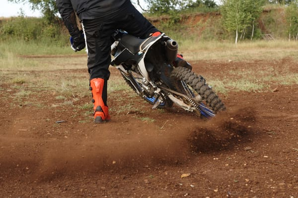 Motorcycle boots in action on dirt track