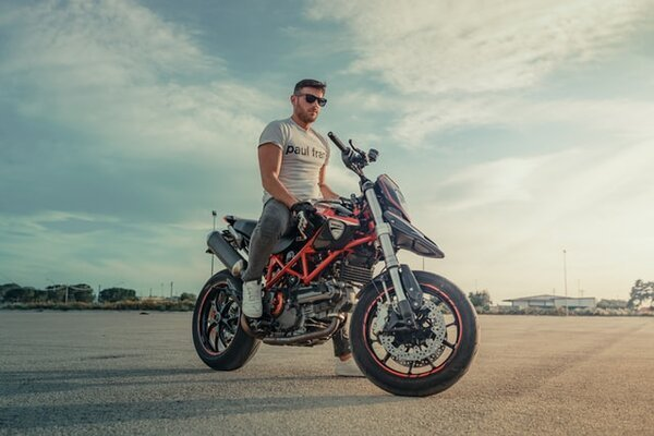 RIDE A MOTORCYCLE WITHOUT A SHIRT